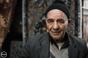 An old man in the Bazaar of Isfahan