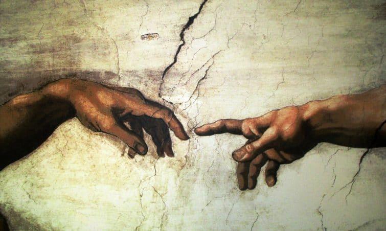 Chapelle Sixtine, photos des doigts qui se touchent
