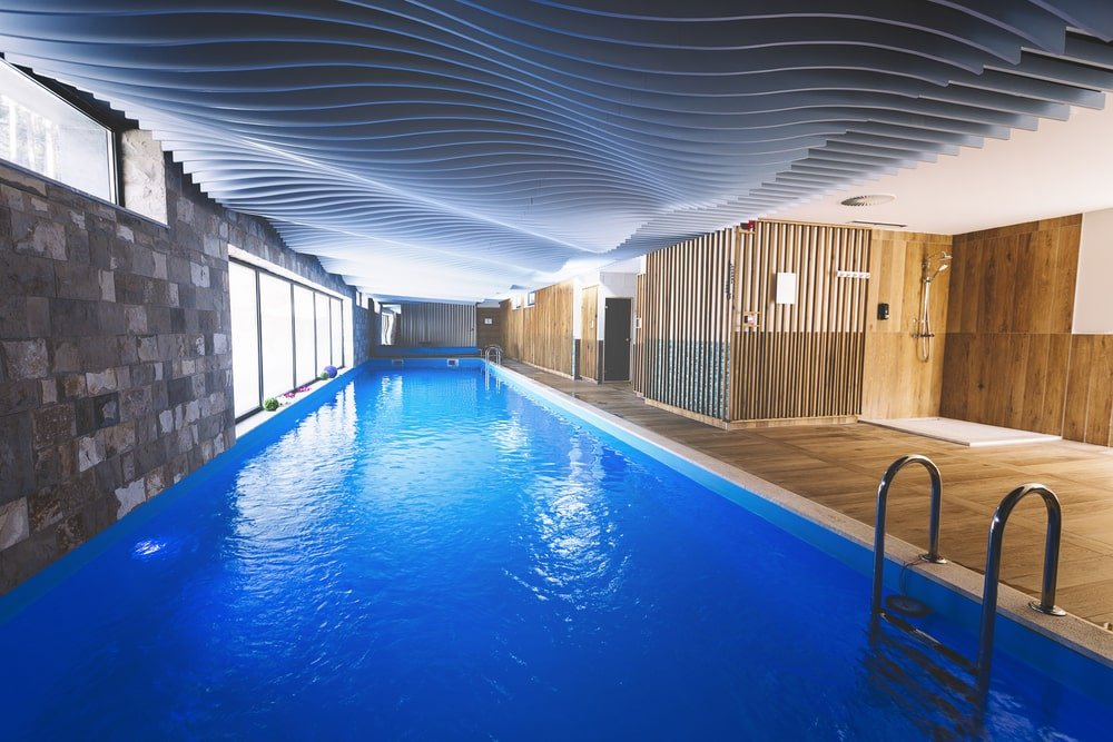 Bern, Switzerland. Indoor swimming pool of a modern luxury house with spa, room with sunbeds.