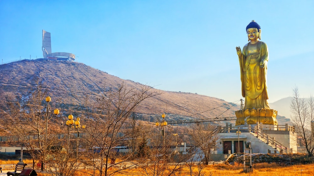 Golden Buddha Statue in Buddha Park near The Zaisan Memorial in Ulaanbaatar, Mongolia