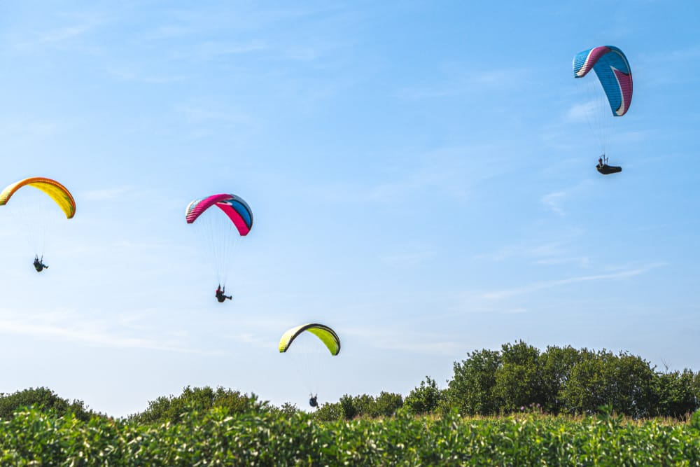 Longues-Sur-Mer, July 2019 Paragliders flying over Longues-Sur-Mer in Normandy, one of D-day landing beaches