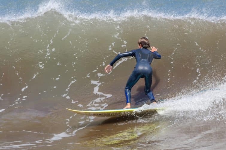 Surfing on the ocean waves. Mashico, Madeira island, Portugal.
