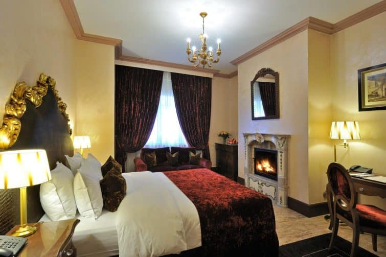 Chambre avec cheminée, Hôtel Le Cigogne, Genève