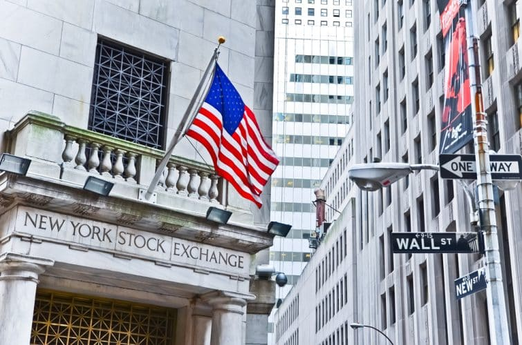 New York Stock Exchange and a street sign of Wall Street