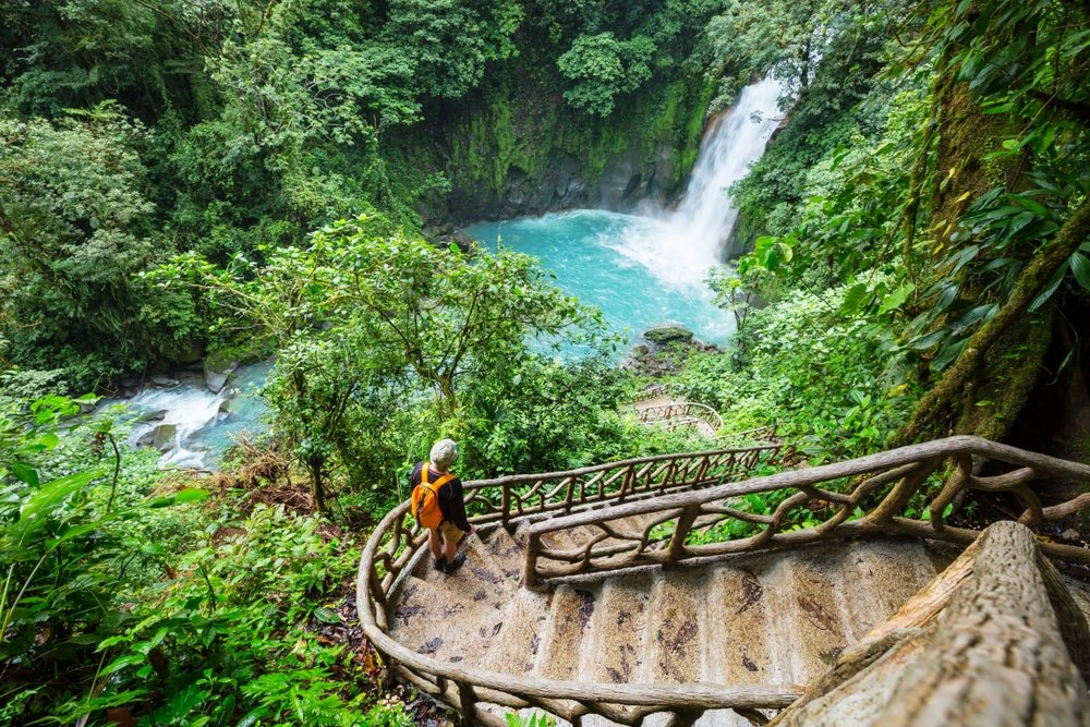 Majestic waterfall in the rainforest of Costa Rica. Tropical hike.