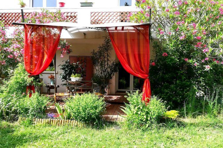 Appartement charmant en rez-de-chaussée avec jardin