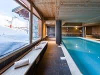 Studio au bord des pistes | Accès Piscine, Sauna, Casiers à ski et+